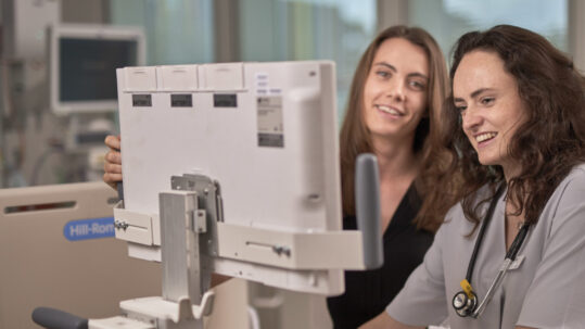 Pictured: Dr Megan WilsonDr Aoife BourkeMonash Health Junior Doctors using EMR devices. Copyright Monash Health. Not for use without prior written permission.